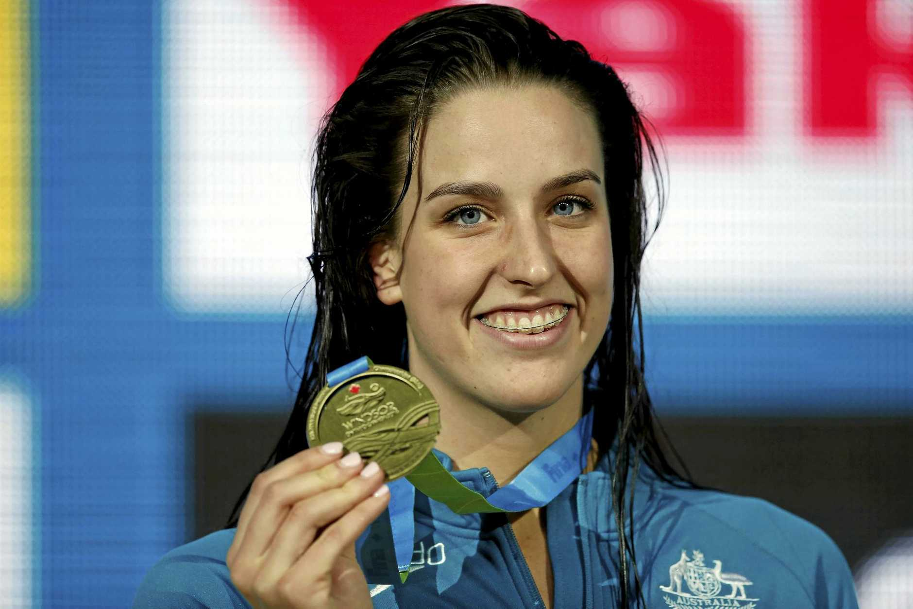 epa05666735 Brittany Elmslie of Australia poses with her Gold medal after winning in the women's 100m Freestyle Final during the 13th FINA Short Course World Swimming Championships at WFCU Centre in Windsor, Ontario, Canada, 08 December 2016.  EPA/PATRICK B. KRAEMER