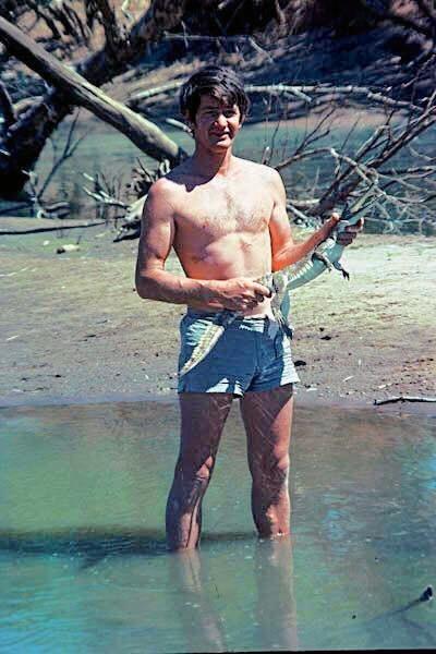 A young Bob Irwin chasing crocs.