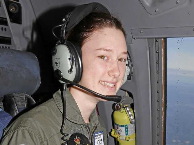 Flight Camp participant Claire Winterbourne experiences the flight deck of a C-17A Globemaster.