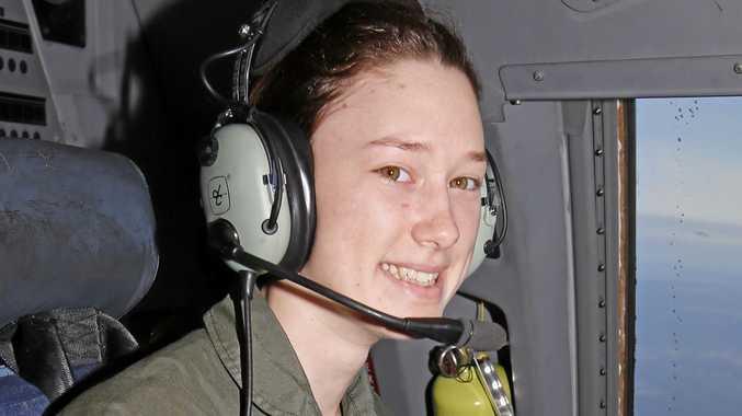 Flight Camp participant Claire Winterbourne experiences the flight deck of a C-17A Globemaster.