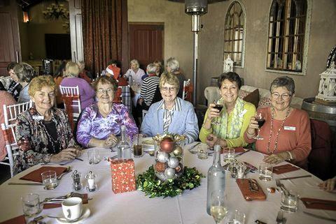TASTY TREAT: Sunnybank Seniors members enjoying their Christmas in July lunch.