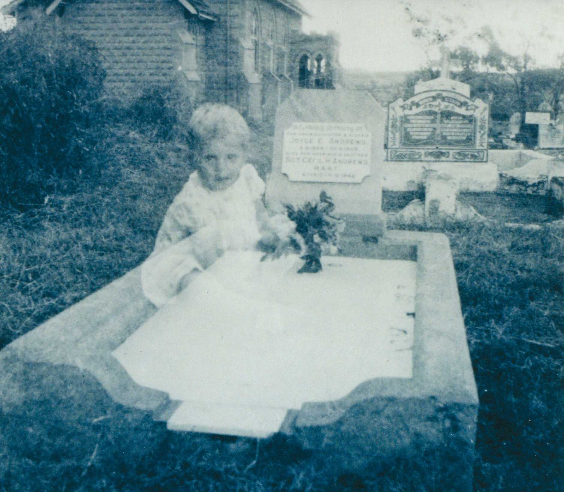 The ghostly image of a child on the grave of Joyce Elizabeth Andrews at a Gatton Cemetery. Lester Andrews