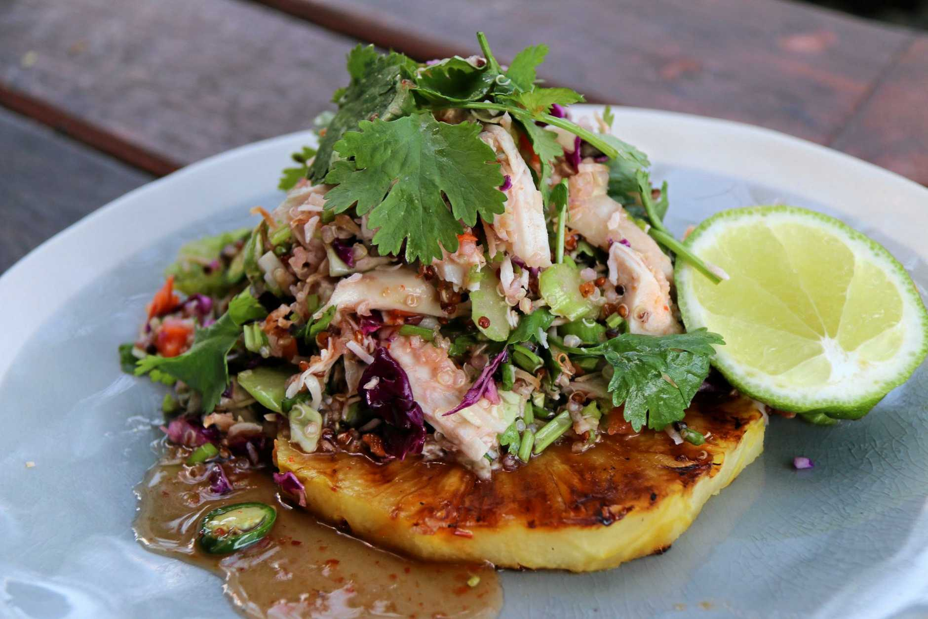 Caramelised pineapple, coconut, quinoa and chicken salad with spicy chilli dressing.