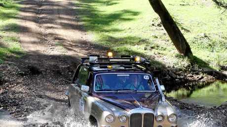 Daimover coming through a creek crossing.