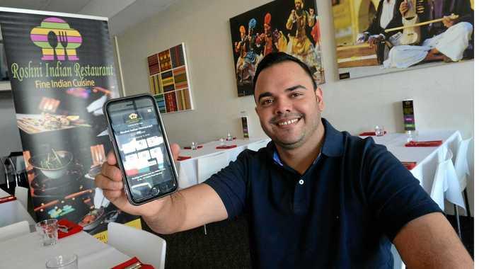 Raj Sharma from Roshni Indian Restaurant shows their new phone app.
