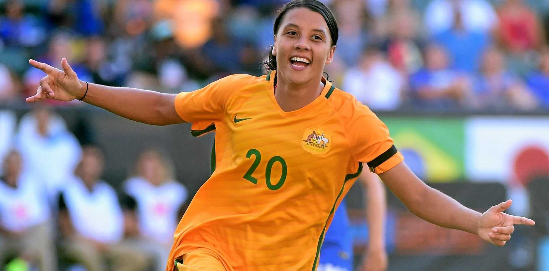 TOP STUFF: Sam Kerr celebrates her goal to take a 6-1 lead over Brazil.