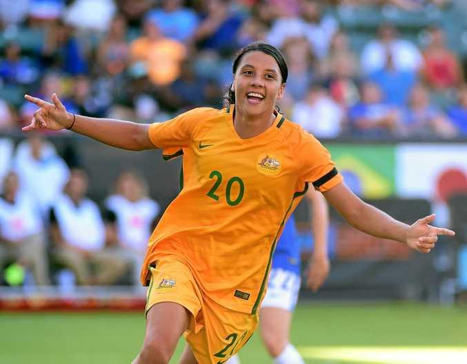 TOP STUFF: Sam Kerr celebrates her goal to take a 6-1 lead over Brazil.