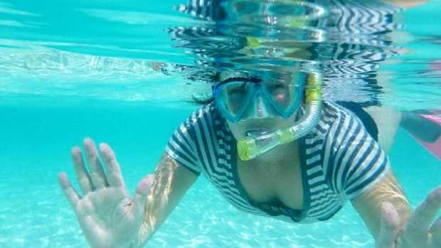 The holiday snap of Linda Hoey scuba diving that led to her being exposed. Picture: SWNS/Mega