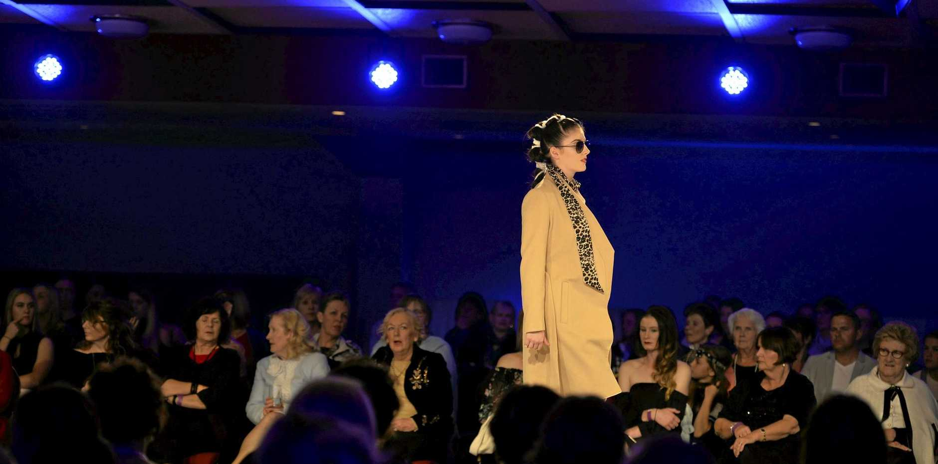 Lauren Creevey models at Stepping Out Winter Glamour event at Rumours International, Saturday, July 29, 2017.