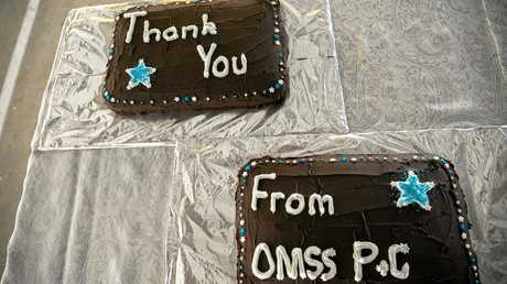 Cake commemorating the efforts of the team that saved and rebuilt One Mile State School.