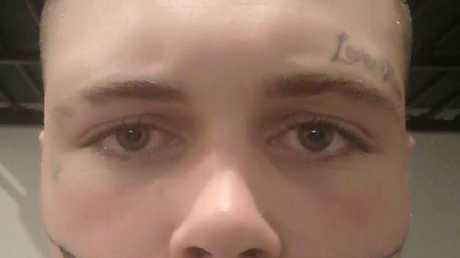 Mark Cropp got his face tattoo in jail.Source:Facebook