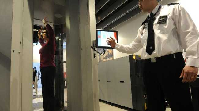 A woman undergoes a full body scan at Melbourne International Airport, a security measure that may be introduced for domestic flights. .Source:News Limited