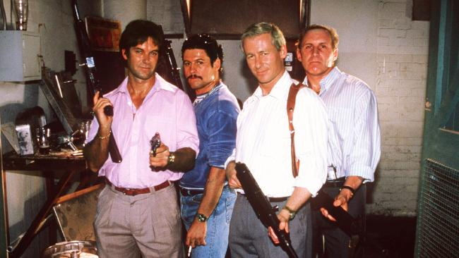 Cast of the original Blue Murder series portraying, left to right, Chris Flannery (Gary Sweet), Graham Henry (Peter Phelps), Roger Rogerson (Richard Roxburgh), Neddy Smith (Tony Martin).