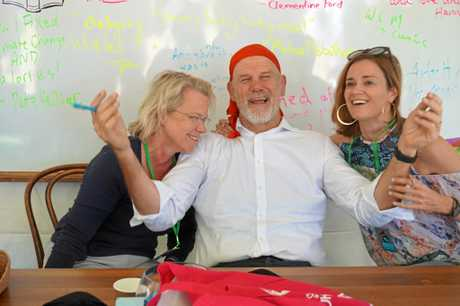 ALL SMILES: Australian Financial Review political editor Laura Tingle, Fairfax columnist Peter Fitzsimons and ABC broadcaster Julia Baird in the book signing tent.