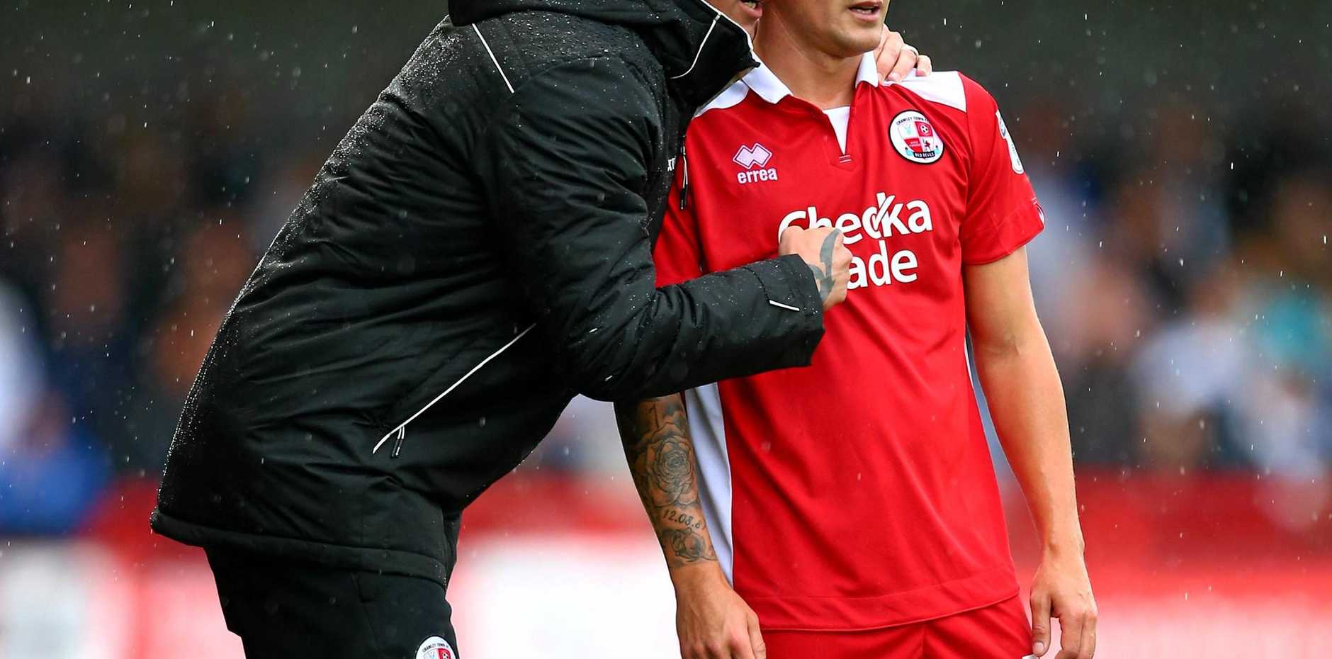Harry Kewell (left) made his league bow as manager with Crawley Town.