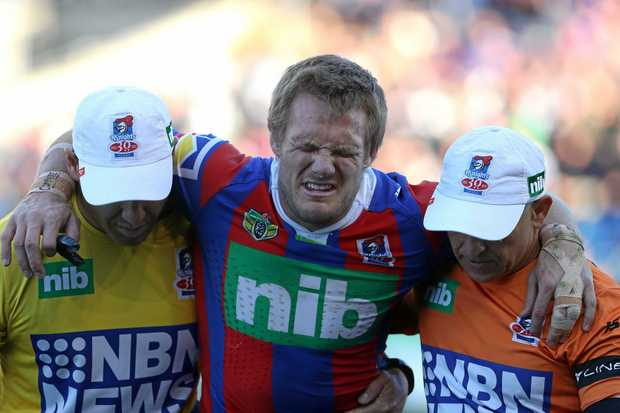 NEWCASTLE, AUSTRALIA - AUGUST 05:  Nathan Ross of the Knights is taken from the ground after getting injured during the round 22 NRL match between the Newcastle Knights and the New Zealand Warriors at McDonald Jones Stadium on August 5, 2017 in Newcastle, Australia.  (Photo by Tony Feder/Getty Images)