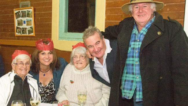 The last picture of Margaret McCullough (left) with Donna Picker, Anne Mendel, Peter Mendel and Joe Kirkwood (Akubra), at the Olinda Community Hall Christmas in July event. Source:Supplied