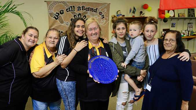 DEDICATION ACKNOWLEDGED: Ipswich's Aunty Faye Carr (centre) has been named the NAIDOC Female Elder of the Year. Family members (from left) Samantha Carr, Aunty Sheryl Thompson, Nahkari Carr-Smith, Kathlean Carr-Smith, Brendon Carr, 4, Keyara Carr and Aunty Lilly Davidson celebrate the honour with her.