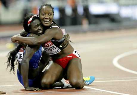 United States' Tori Bowie, left, celebrates with Trinidad and Tobago's Kelly-Ann Baptiste