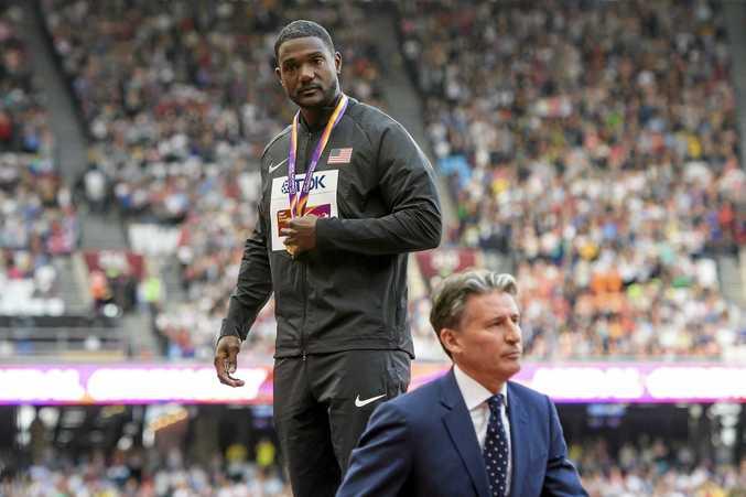 Gatlin after receiving his gold medal from  IAAF president Sebastian Coe  in London