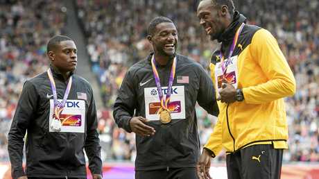 Christian Coleman, Justin Gatlin,  and Usain Bolt after the medal presentation.