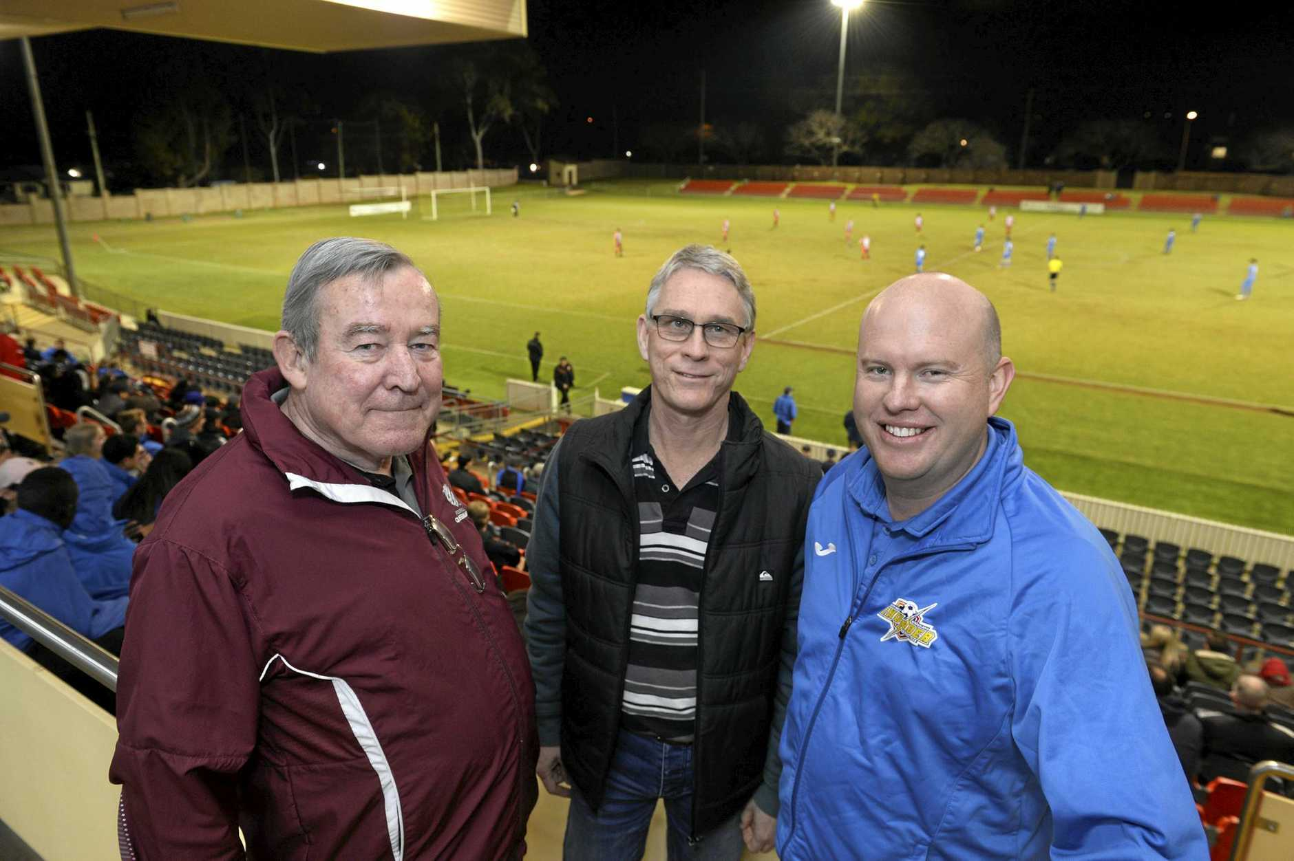 Football Queensland chief executive Geoff Foster (left) and president Greg Redington OAM with South-West Thunder president Wade Eiser (right) at the Thunder home game against Olympic in NPL Queensland round 19 football at Clive Berghofer Stadium, Saturday, July 29, 2017.