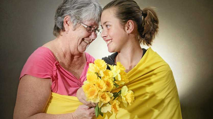 DAFFODIL DAY: Secretary of Maclean Patchwork and Quilters, Robyn Plater, with granddaughter Ashley Luland, wraps up preparations for an annual Daffodil Day morning tea.