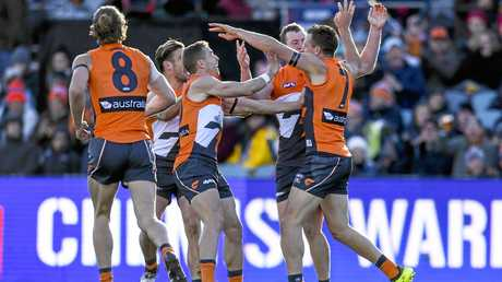 Brett Deledio celebrates with team mates after scoring his first goal for the Giants.