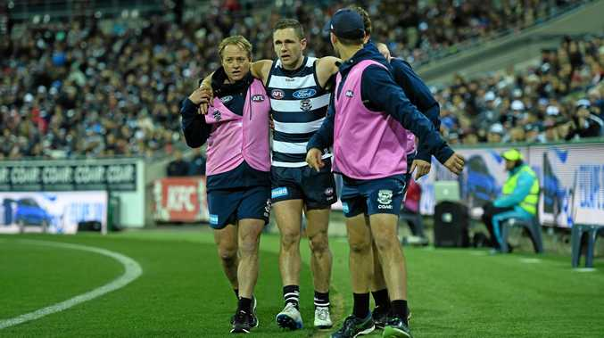 Joel Selwood  is carried from the ground on Friday night.