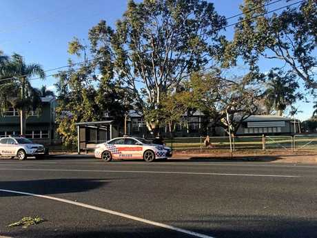 Police search West Mackay after a home invasion on Friday.
