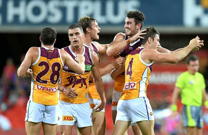 DERBY TIME: Brisbane Lions players celebrate scoring a goal in the round one QClash win.