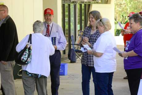 SPOTLIGHT: Voters arrive to get their how-to-vote cards from (left to right) Cr Paul Tully, Conny Turni, Lyn Paff and Diane Hamilton as pre-polling opens across Ipswich for the mayoral race.