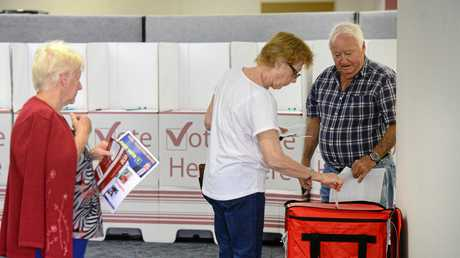 IN YOU GO: Electors make their choice at the WG Hayden Humanities Centre pre-poll voting booth.