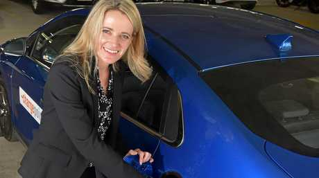 PLUGGED IN: Hyundai Australia northern region business sales manager Louise Andrews plugs in a new electric model at Sunshine Coast University Hospital.