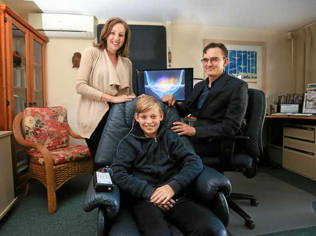HEALING THE MIND: Neurofeedback facilitator Rustam Yumash with Elisha McDonald and her son Henry McDonald, 12.
