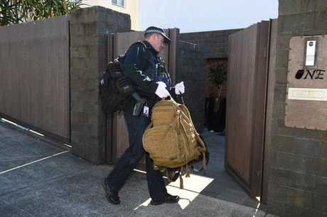 Police are seen at the home of Kings Cross club owner John Ibrahim during a police operation in Sydney