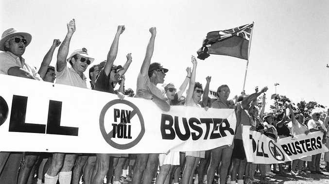 Tollbusters members protest beside the Sunshine Motorway in October 1990.
