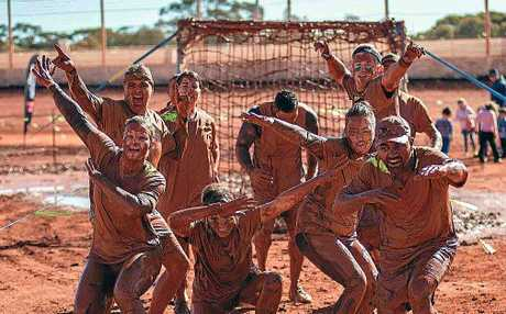 CHEERS: Mud dabs all round at Obstacle Hell.