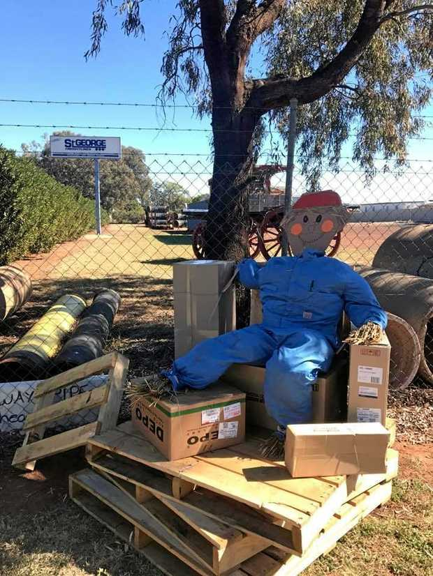 DRAWING STRAWS: Businesses throughout town, including St George Freightliners, are busy making scarecrows to get in the spirit for St George State School's fete next month.