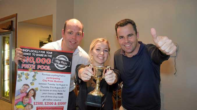 GOOD EATING: Paddy Gorman, Phoebe Walton, and Sam Ingham-Myers celebrate being voted City Pride's winner of Best Pub Grub.