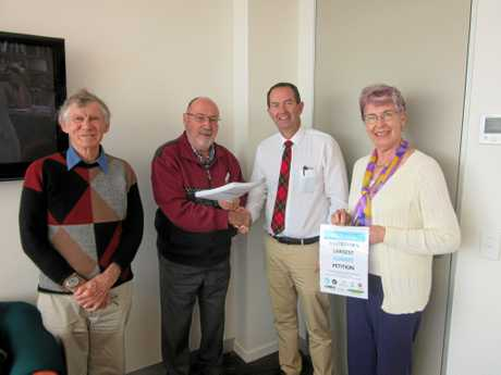 CHURCH group leaders (from left) Dr Ray Barraclough (Anglican), Bob Cullen (Catholic), Andrew Wallace MP and Mrs Wendy Lowry (Uniting Church) at the hand over of the petition signed by more than 1000 people.