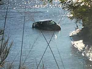 Mystery surrounds car towed out of Brisbane River