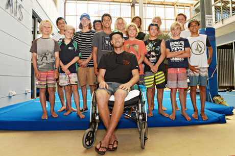 Bede Durbidge giving the Juniors Tips at a Surfing Australia camp not long after his horrific wipe-out left him with a fractured pelvis.