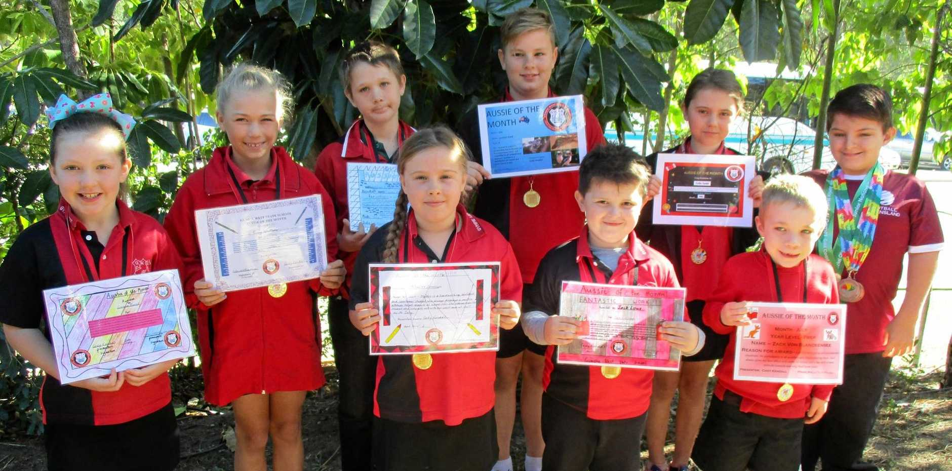 PROUD MOMENT: Guest presenter Cody Kendall (back right) returned to his old primary school to present Gympie West's Aussies of the Month with their medals and certificates. They are (back from left) Sienna Burns, Romy Whittaker, Aaron Knight, Lochlan Hand, Leila Gadd, (front) Maelee Sorensen, Jack Lowe and Zack Von Blanckensee.