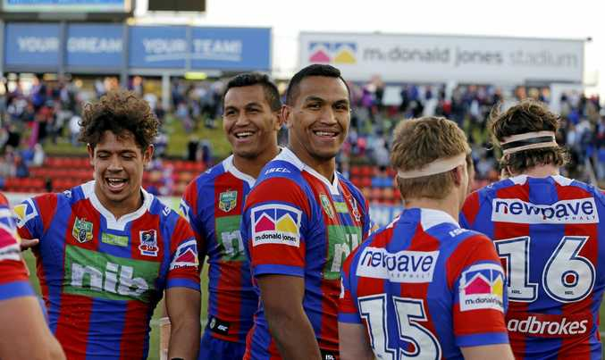 Knights players celebrate their win over the Warriors  in Newcastle