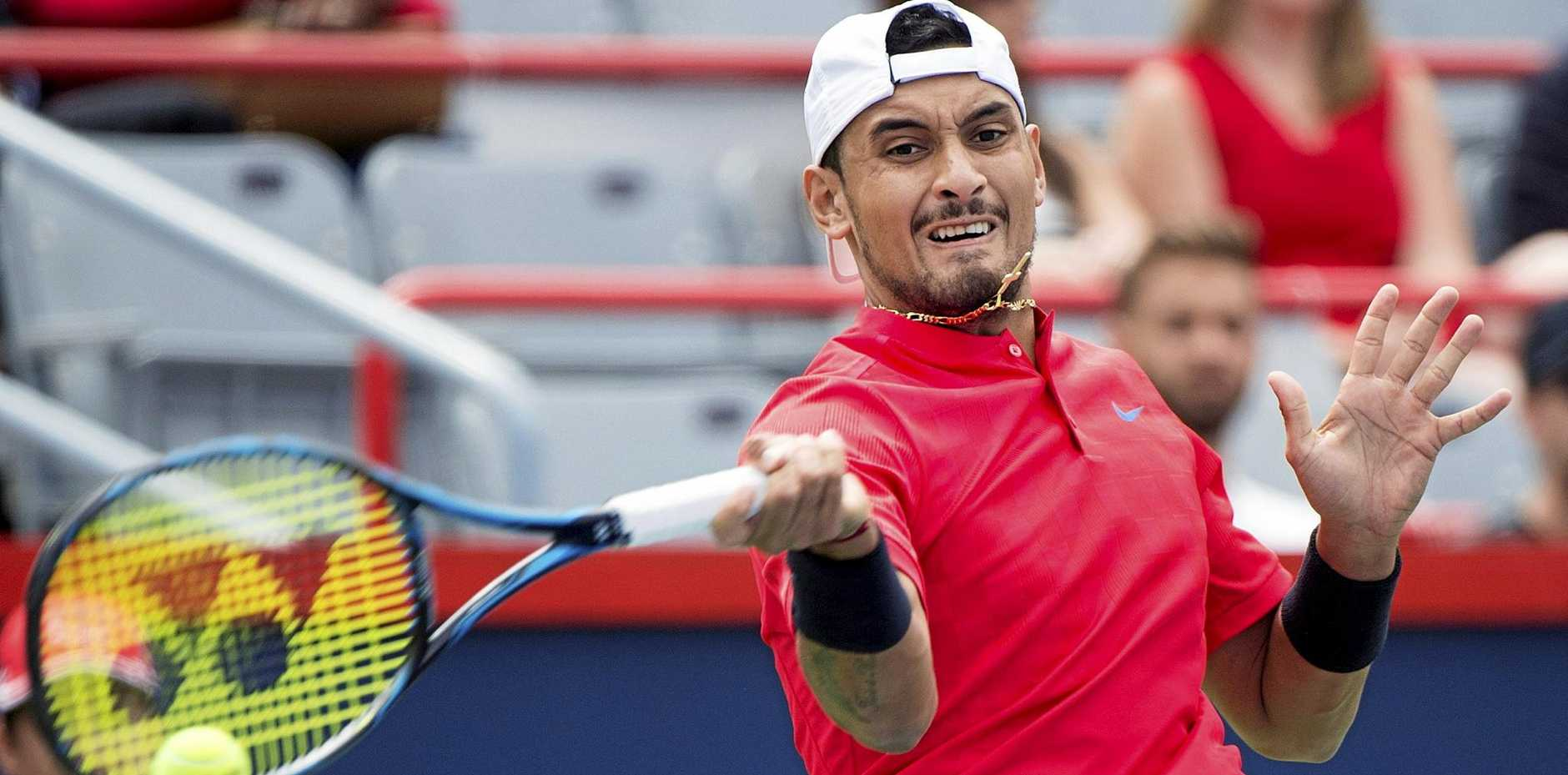 Nick Kyrgios in action against Viktor Troicki at the Rogers Cup tennis tournament in Montreal.