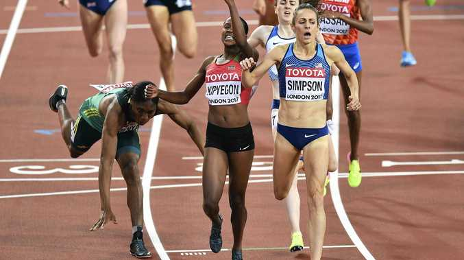 Kenya's Faith Chepngetich Kipyegon, centre, celebrates as she wins the women's 1500 meters final from silver medalist United States' Jennifer Simpson, right, as bronze medalist South Africa's Caster Semenya, left, falls.