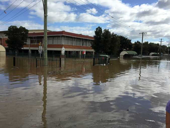 Testing of the grounds at Trinity Catholic College found soil contamination hotspots after the flood.