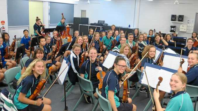 EAGER TO PLAY: Students enjoy a joint venture between the music departments of Sunshine Beach primary and high schools.