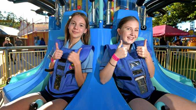 LEARNING: Sarah Jobson, 15, and Kaylah Dixon, 15, test out the new technology wearing the safety vest and downloading the SPARKvue app to test speed, distance and g-force.